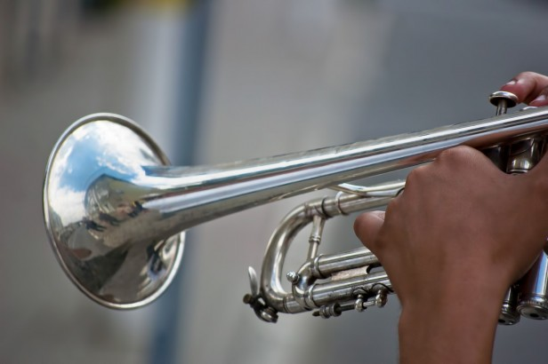 A close up of a trumpet being played