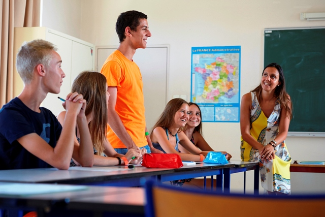 students smiling during a French lesson