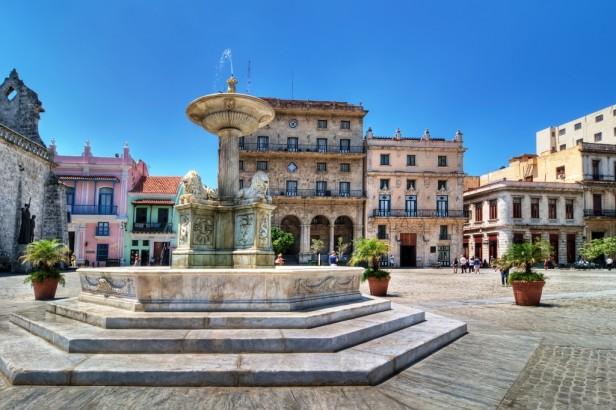 Colonial architecture in square with fountain in Havana, Cuba