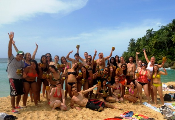 happy group of people at playa grande in Sosua