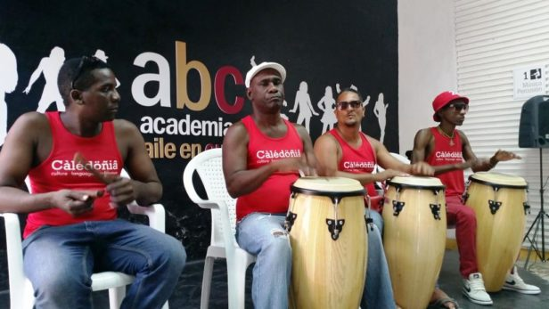 group of percussionists playing conga drums