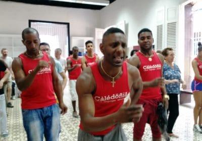 dance teacher giving instruction in dance