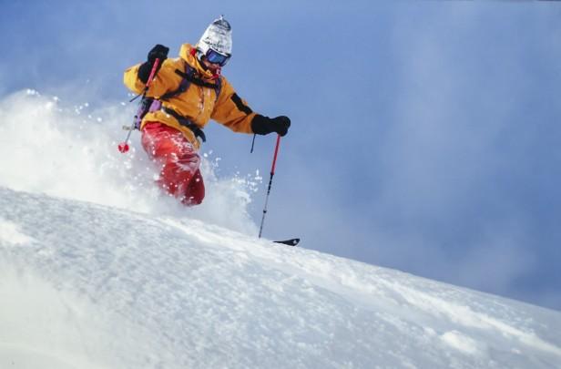 Man skiing down ski slope in Kitzbuhel