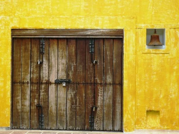 A weather worn brown door