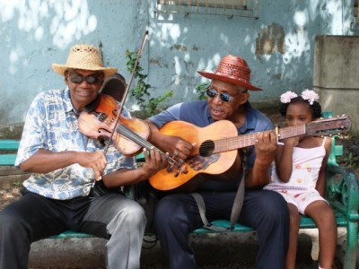Men playing guitars, cuba