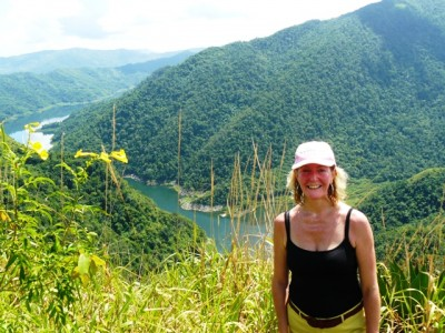 green mountains and smiling woman