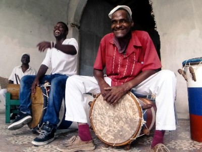 Men playing Cuban folkloric drums