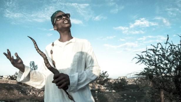 Afrocuban man holding a horn staff