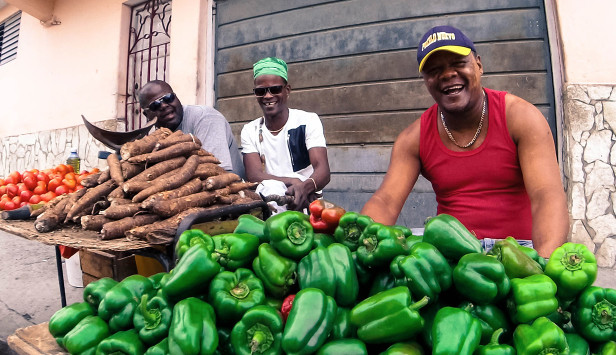 Green peppers and vegetables, smiling vendors