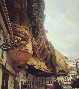 Cafes and bars under overhanging rock