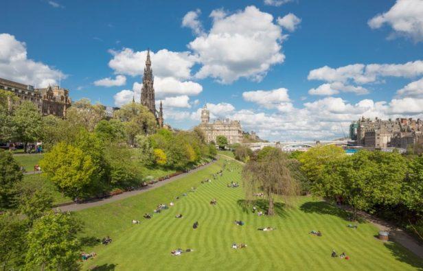 People sunbathing in Edinburgh Princes Street Gardens
