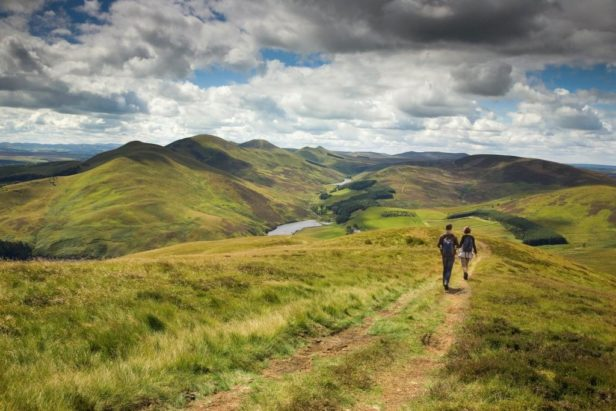 couple walking through the Pentland Hills
