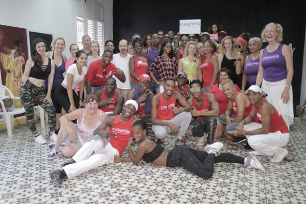 A group shot of dancers and dance holiday participants gathered in the dance studio in Santiago de Cuba