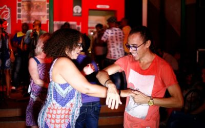 A woman and man dancing salsa in a club