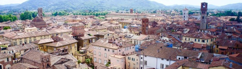 View overlooking the historic town of Lucca with green mountains in the background