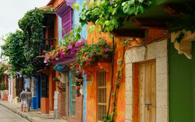 Colourful street, flowers hanging from balconies