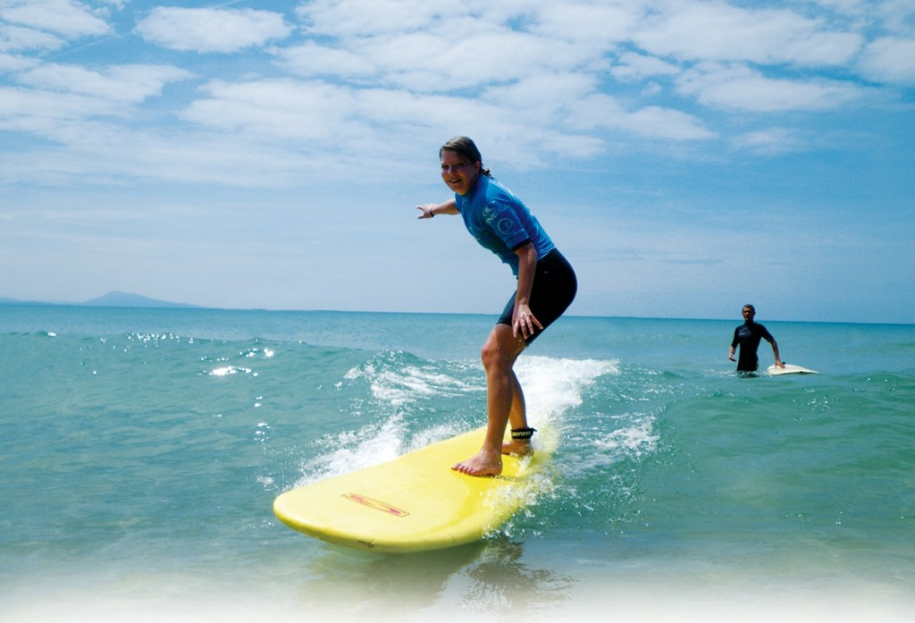 young person on a surfboard in sea