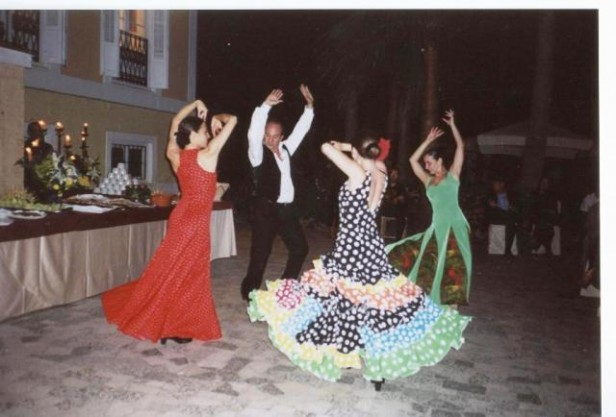 Flamenco dancers performing in the street at night