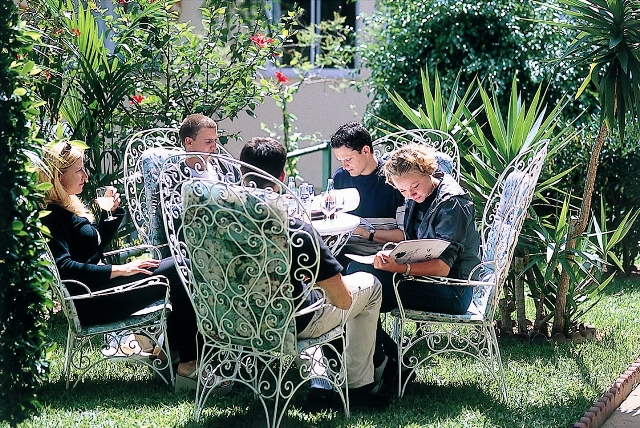 Students sitting and studying in the garden